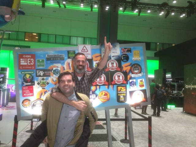 Sunset Overdrive Game Director Drew Murray celebrates a successful E3 2014 by jumping on Creative Director Marcus Smith's back